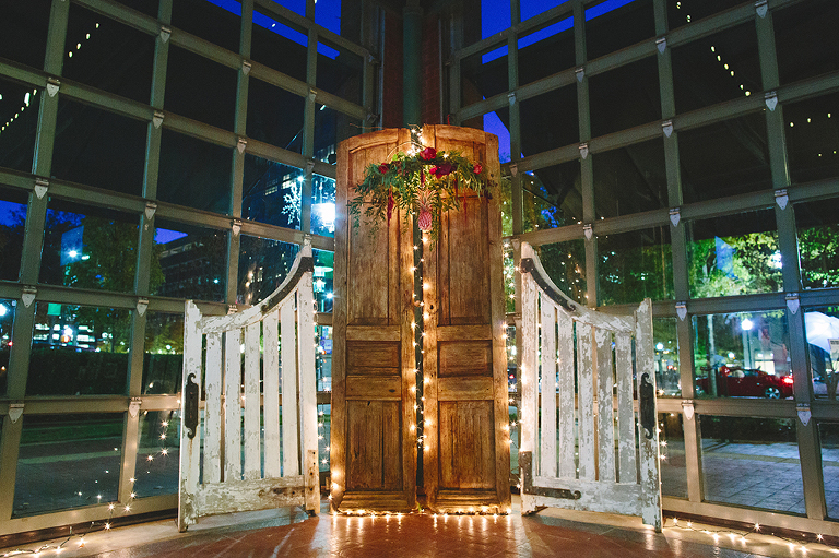 wedding-ceremony-backdrop-with-rustic-doors-twinkle-lights-and-floral-chandelier